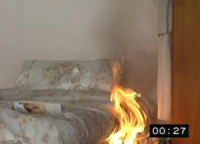 Still of a video at 27 seconds - fire has spread rapidly to nearby furniture